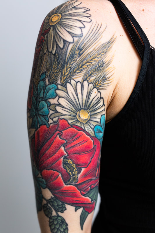 woman poppy floral flower flowers color feminine tattoo tattoos