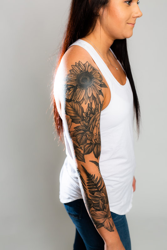 black grey sunflower sleeve woman feminine floral tattoo