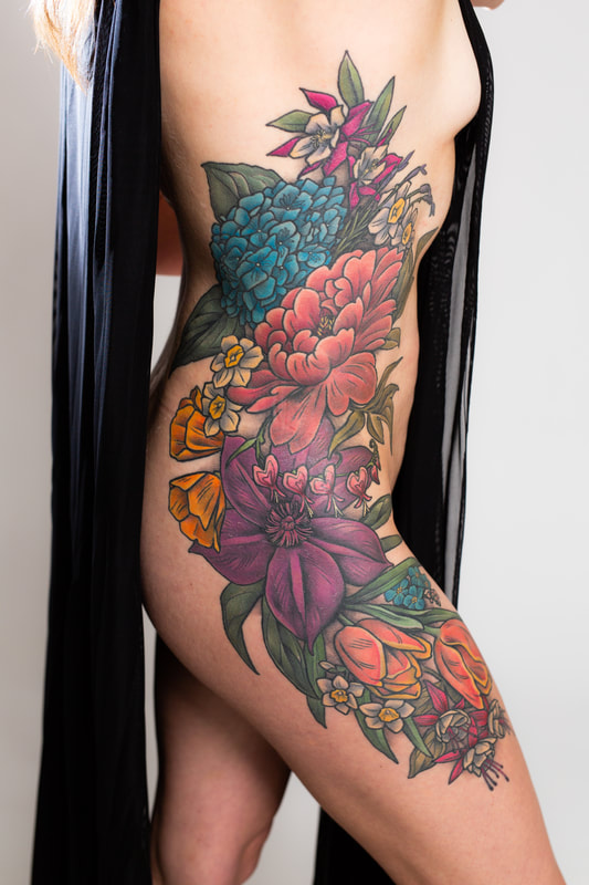 woman floral flower tattoo tattoos ribs hip color side