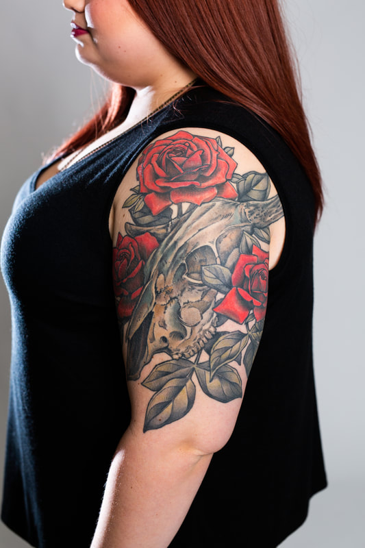 skull roses leaves floral flowers flowers sleeve tattoo